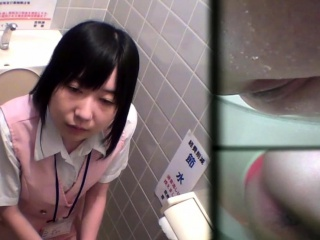 Asian teen pees near powder-room