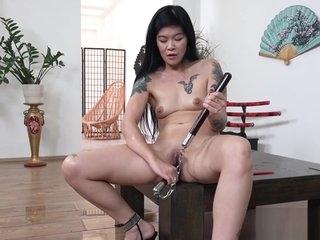 Hot geisha peeing and dildoing herself