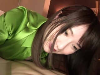 Hot girl wear shinning green silk satin blouse doing massage for guest